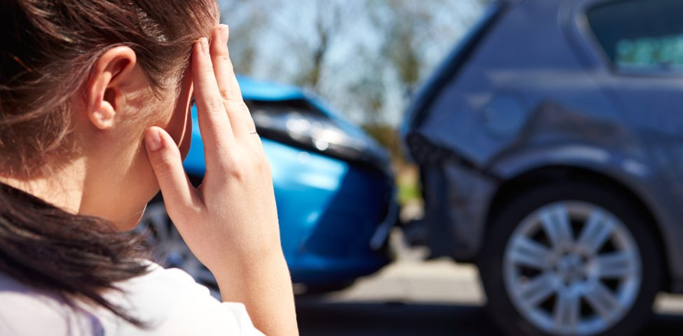 Stressed Woman in a Car Accident
